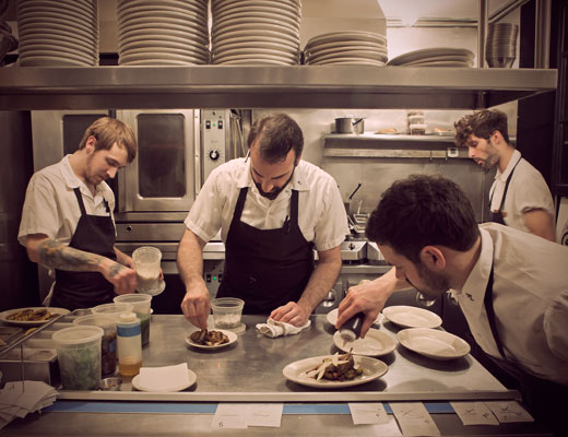 Four chefs preparing food at Rucola