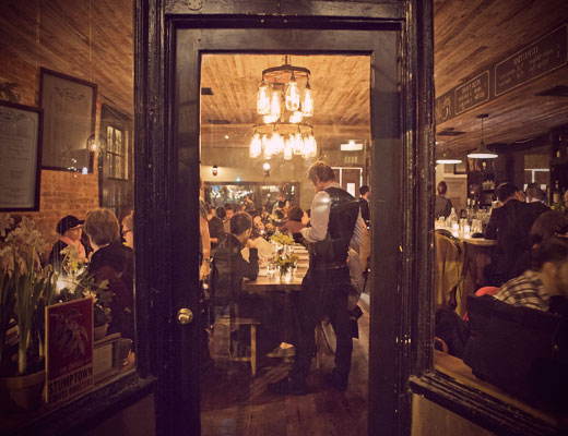 Waiter and diners at Rucola