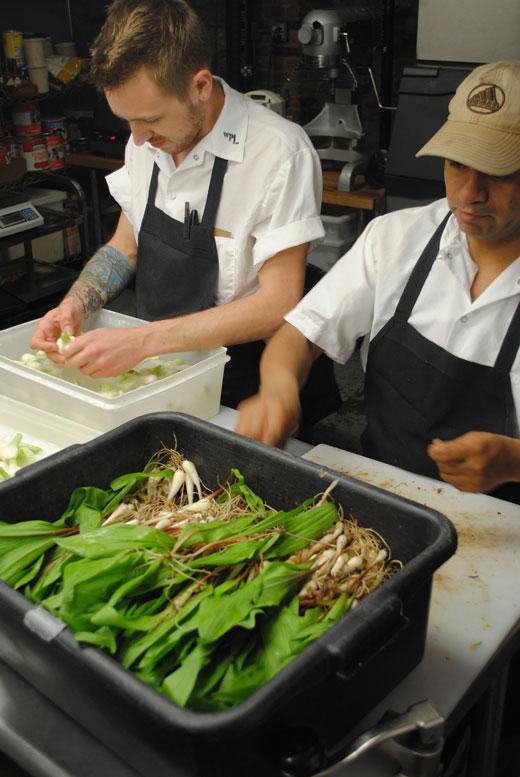 pair of chefs preparing fresh ramps
